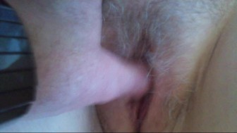 Fingering my wife's hairy pussy.