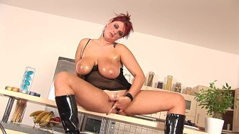 Chubby redhead Kamila lubes herself up