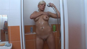 Cute blonde euro chick showering off
