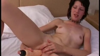 Skinny amateur Nora plays with big dildo