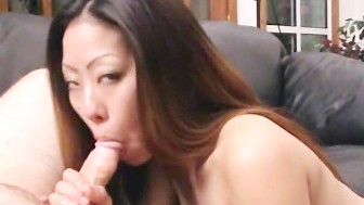 Hot asian girl strokes cock