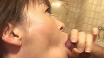 Horny slut sucks big Asian cock in bathroom
