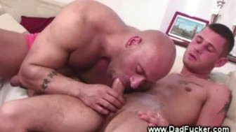 Gay muscle and stud suck each others cock off on their sofa