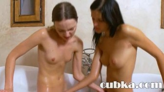 Two lezzies toying in the tub