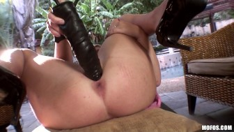 Cute petite blonde babe Kelly Surfer rides her new toy to orgasm
