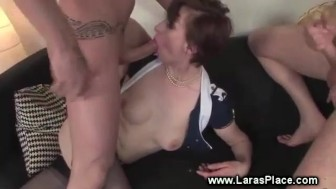 Mature in stockings taking two cocks