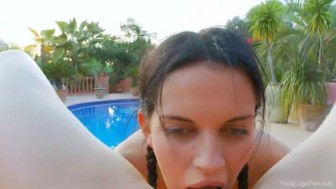 Friends threesome by the swimmingpool
