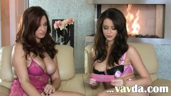 Two busty brunette lezzies in stockings