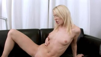 Blonde babe fingering on leather couch