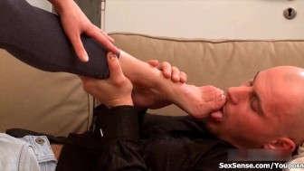 Hot brunette babe jerks an hard cock with her sexy feet