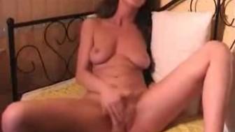 Nasty naked brunette masturbates