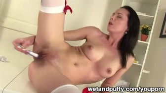 Cute nurse plays with her pussy
