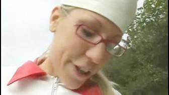 Nurse treats old cock outdoors