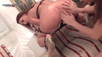 Glamour lesbians with a strap-on