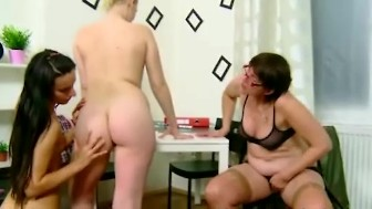 Two sexy teens get seduced by their old lesbian teacher in the classroom