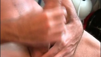 Greg, a very sexy guy get wanked his very huge cock by a guy !