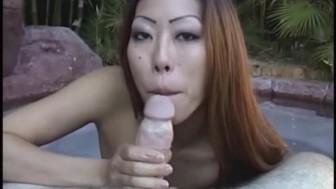 Asian amateur gives an outdoor blowjob