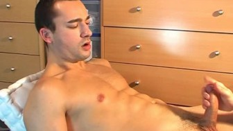 Alex, a very sexy soccer player gets wanked his hard cock by a guy in spite of him!