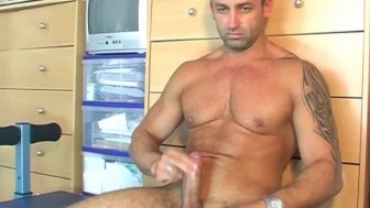 Reno gets wanked his huge cock by us !