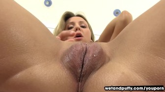 Wetandpuffy Blonde beauty sliding glass dildo in her shaven pussy