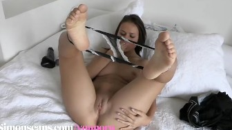 Denise Sky lays on the bed and mastubates