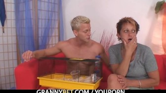 Granny rides her neighbour's cock