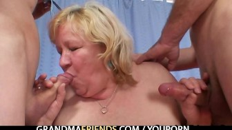 Huge grandma pleases two young cocks
