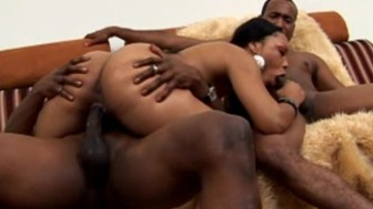 Small Tit'd ebony babe takes on two big black cocks