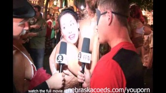 goofy guys interviewing naked girls on the streets of key west fantasy fest