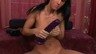 Brunette takes in two big dildos