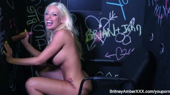 Hot Blonde named Britney sucks a big cock in the glory hole