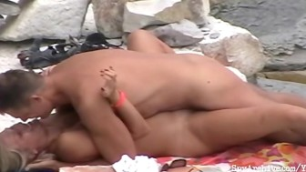 Blonde girlfriend gets penetrated on the beach