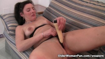 British mom in tights fucks a dildo on the couch