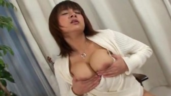 Asian babe with a hairy muff pleases herself