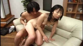 Young cute Oriental in white socks fucked hard on the sofa