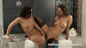 Naughty games leave lesbian lovers soaked with pee