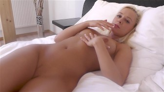 Cute blonde Naomi strokes her pussy for a real orgasm