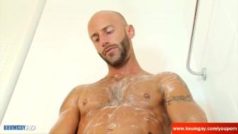 Handsome Gym trainer gets filmed hard in a shower in spite of him !