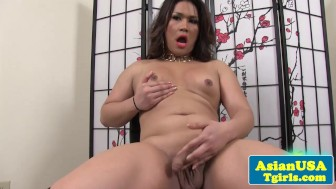 Ladyboy toying her big ass and tugs tiny cock