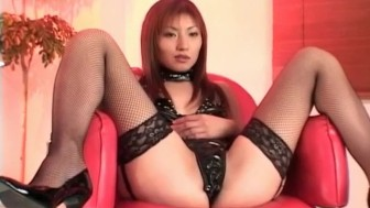 Hitomi Ikeno in black lingerie gets sex toys in and on hairy slit