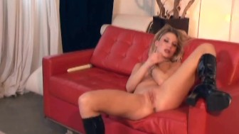 Pretty blonde masturbates on a chair in boots