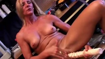 Gorgeous mature blonde in high heels fucks a huge dildo
