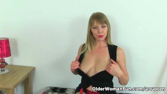 British milf Abi Toyne masturbates in black stockings