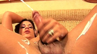 Tranny slut rubs her big cock with creamy lotion and cums