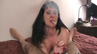 Housewife gives blowjob while smoking cigarette