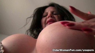 Busty milf April White peels off her soaked panties
