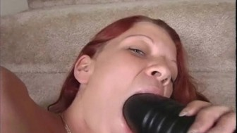 Redhead with a brutal dildo