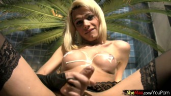 Shemale gets her shecock hard by stroking and jizz cumming