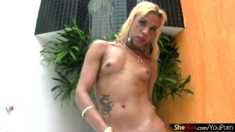 Slim Latina shemale in black bikini masturbates in jacuzzi
