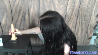 Russian shemale toying her ass with dildo